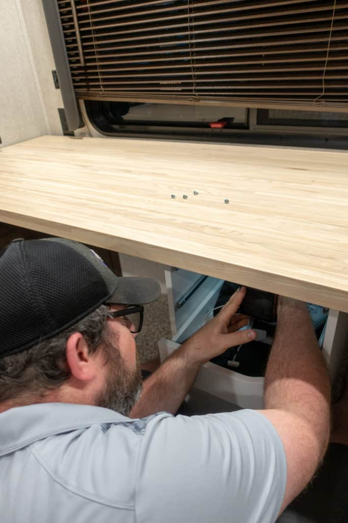 Barrett working on dual desk assembly