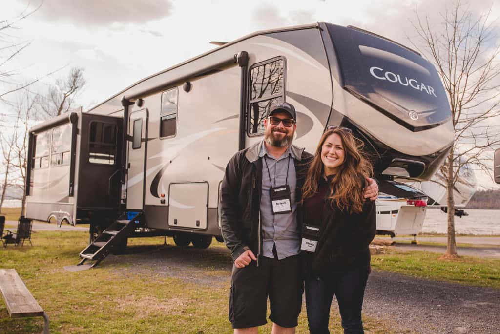 cindy and barrett in front of their keystone cougar fifth wheel