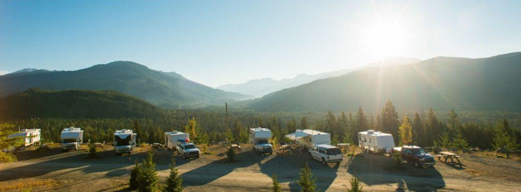 A row of different types of RVs