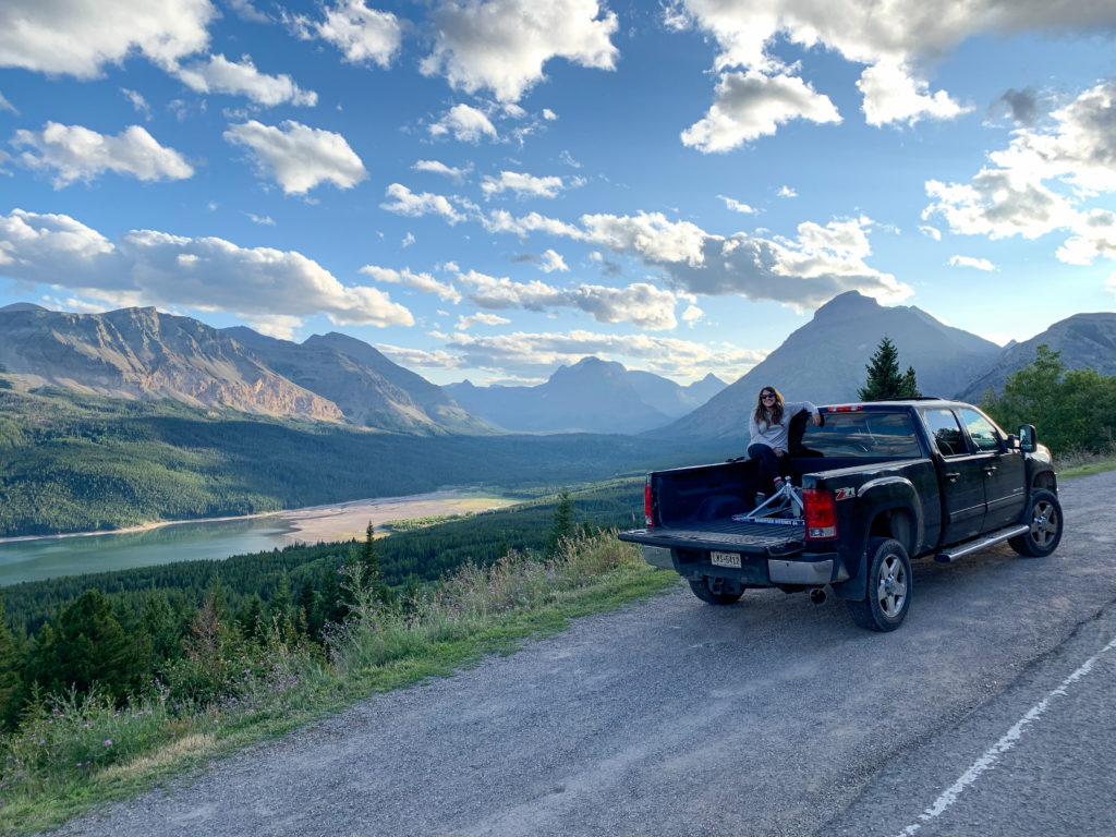 Cindy in the bed of our truck in Glacier National Park